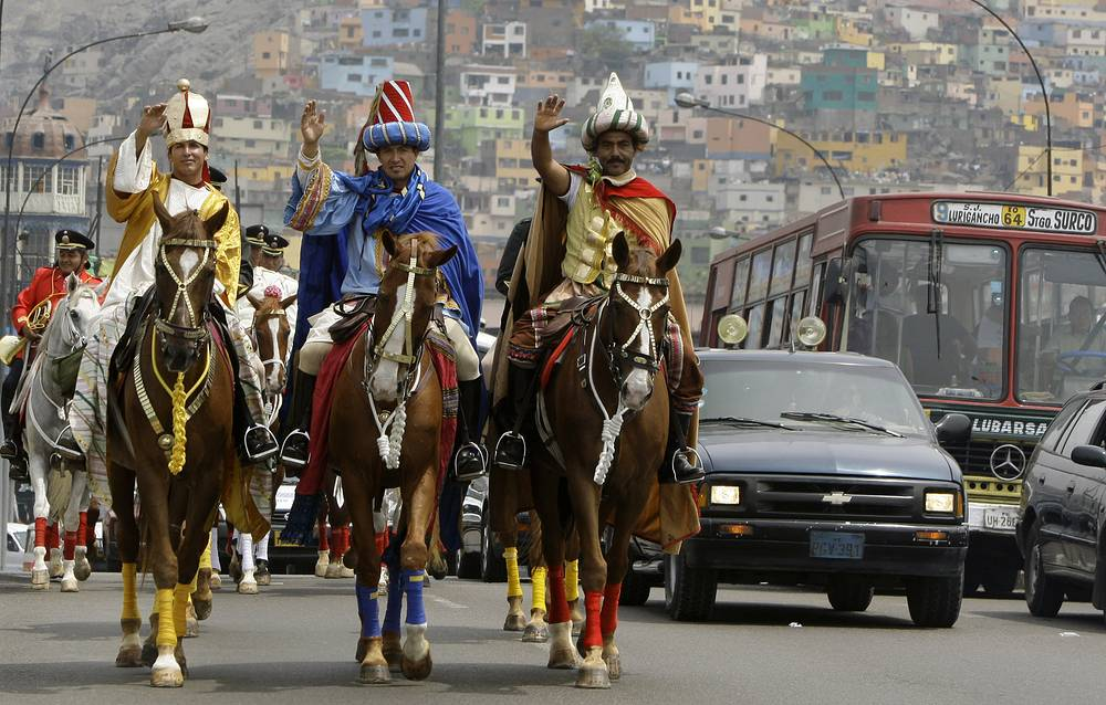Photo: Police officers dressed as the Three Wise Men or Three Kings parade in Lima