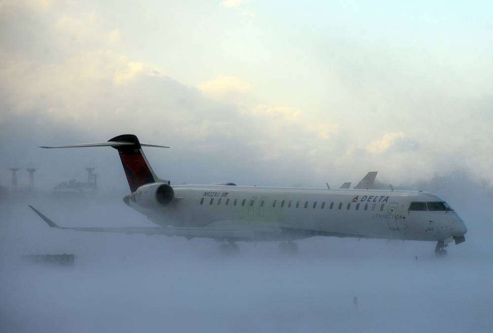 Lake-effect snow storm with freezing temperatures affected travel, like this plane that negotiated its way through the snow at Buffalo Greater International Airport, in Buffalo, N.Y. November 18, 2014