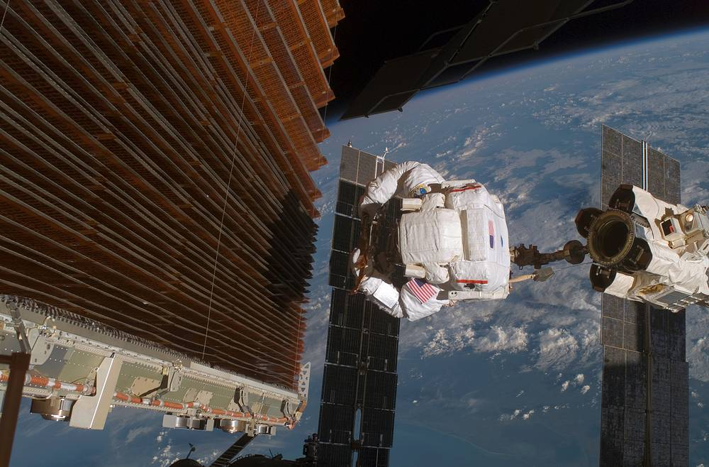 The electrical system of the International Space Station uses solar cells to directly convert sunlight to electricity which allows the crew live comfortably and safely operate the station. Photo: Astronaut working with the port overhead solar array wing, 2006