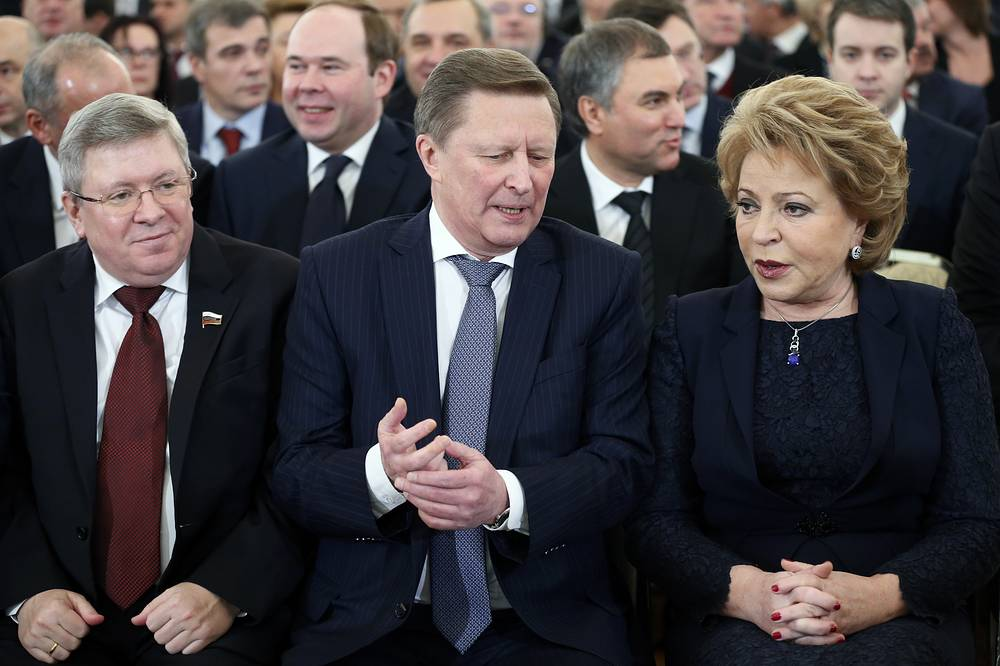 Vladimir Putin called hypocritical the use of human's rights issue to cover for the state coup in Ukraine. Photo: Russian Federation Council First Deputy Chairman Alexander Torshin,  Chief of the presidential administration Sergey Ivanov and Federation Council Speaker Valentina Matviyenko during Russian President's annual state of the nation address