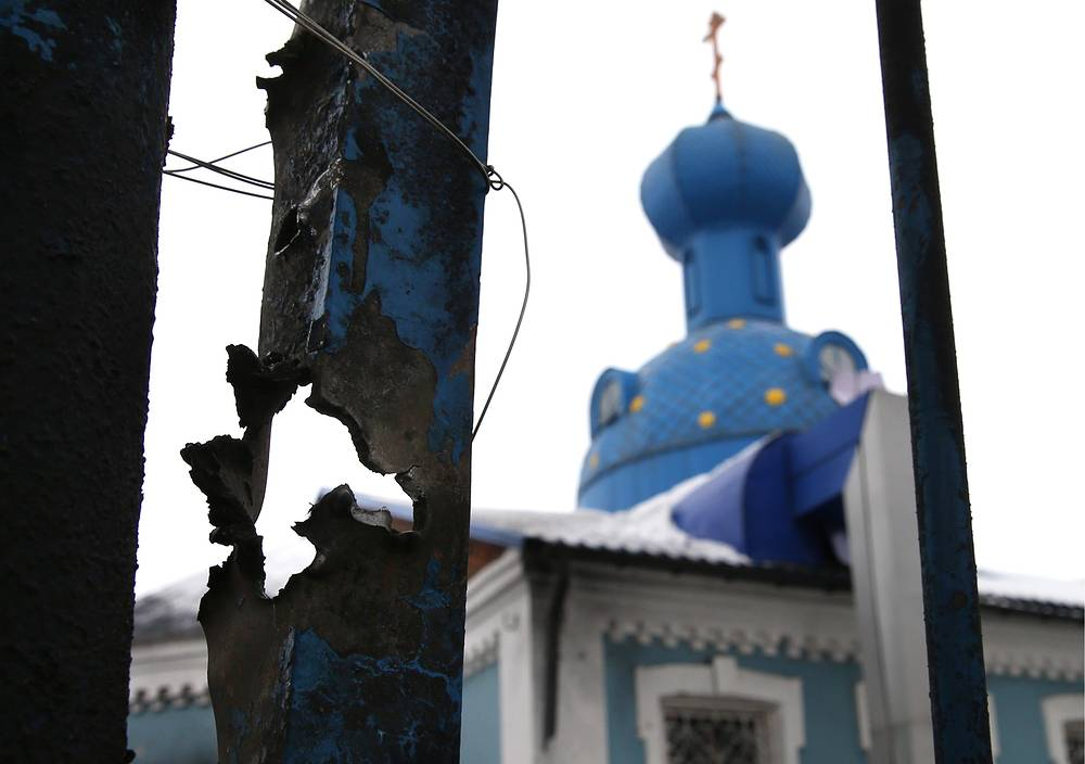 Photo: A fence damaged during a shelling attack in Donetsk