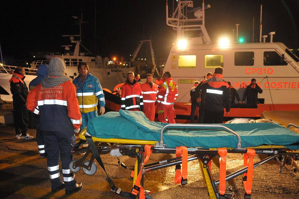 Photo: Evacuation of passengers from the Norman Atlantic ferry in the harbour of Otranto, Italy