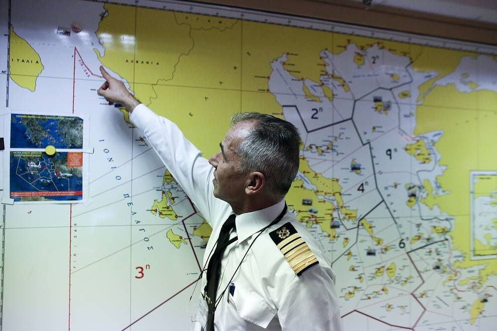 Photo: Athanasios Athanasopoulos chief of Greece's coast guard indicates the last known position of the stricken Italian flagged Norman Atlantic ferry, December 28, 2014
