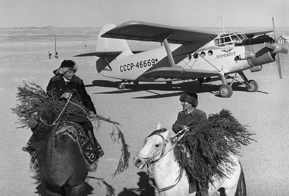 Antonov An-2 aircraft delivered New Year trees to local residents in Bukhara Region, Uzbek SSR, 1965