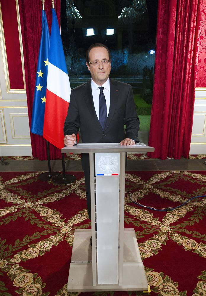 "French President usually finishes his New Year message with words: ""Long live the Republic, long live France!"" Photo: Francois Hollande addressing his New Year's wishes to the nation during a pre-recorded broadcast speech at the Elysee palace in Paris, France, December 31, 2012"