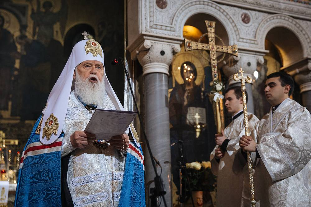 Prayer service during the Orthodox Christmas Eve mass in St. Volodymir cathedral, Kiev, Ukraine