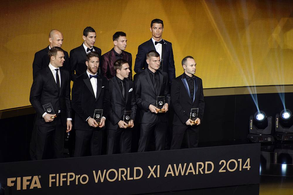 Manuel Neuer, Sergio Ramos, Philipp Lahm, Toni Kroos, Andres Iniesta, Arjen Robben, Angel Di Maria, Lionel Messi and Cristiano Ronaldo with their trophies after winning the FIFA FIFPro WORLD XI Award of the Year 2014