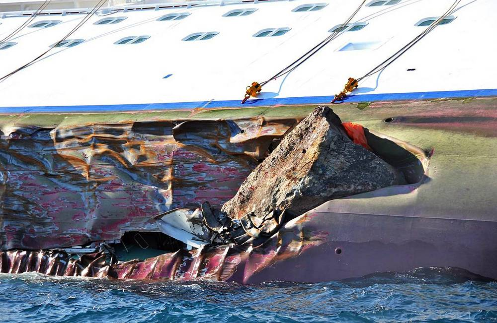 Photo: A close up of the Costa Concordia cruise ship in northern Italy, 14 January 2012, after she ran ground