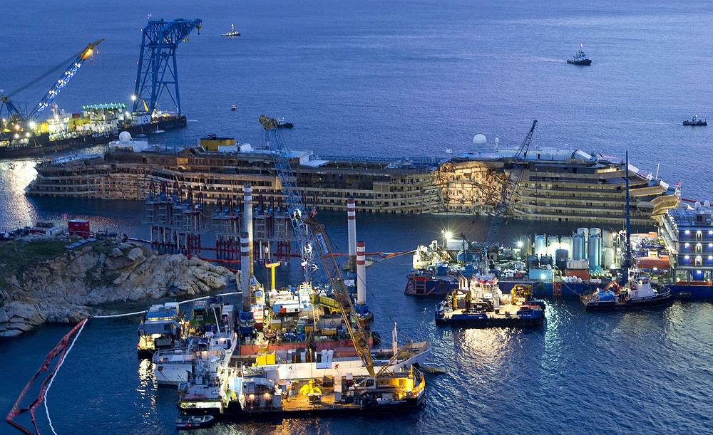 Photo: Costa Concordia is seen after it was lifted upright, on the Tuscan Island of Giglio, Italy