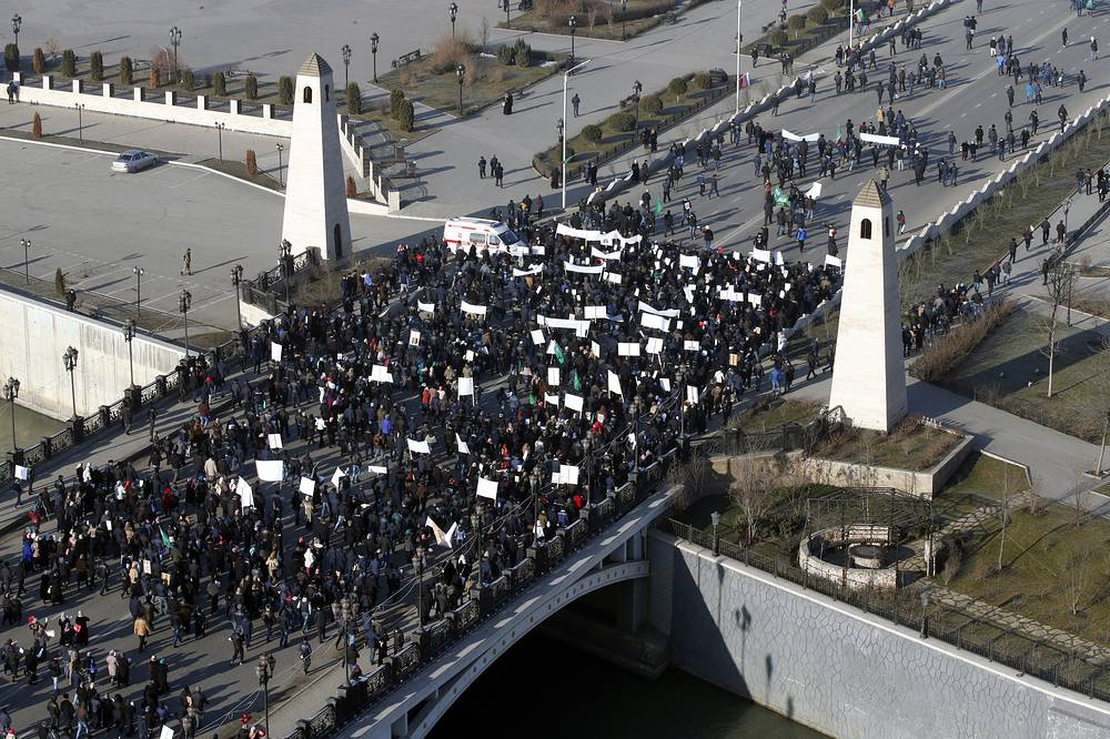 Photo: Demonstrators cross the bridge as they march through central Grozny