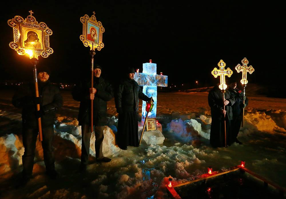 Russian Orthodox priests carrying crosses and icons ahead of the procession of the Cross marking the Orthodox Epiphany in Ivanovo region