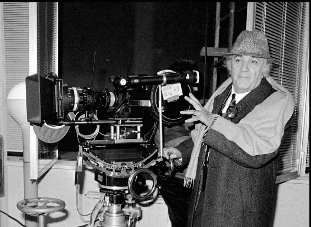 Federico Fellini directs on the set of his movie Fred and Ginger during filming at Rome's Cinecitta studios in 1985