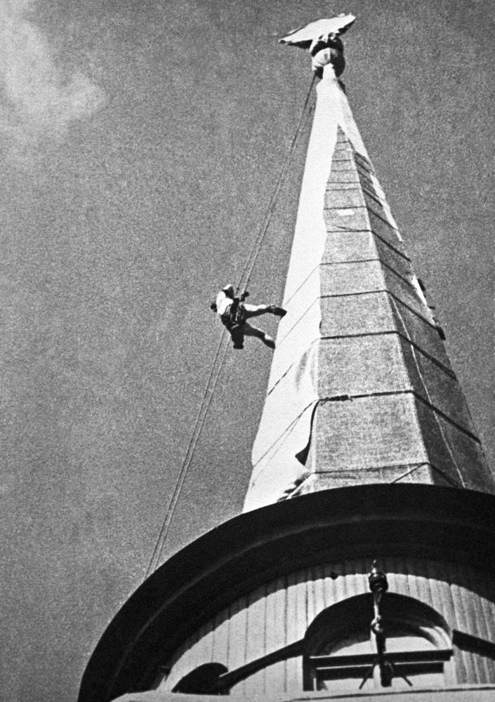 Spire of Admiralty being concealed by alpinist
