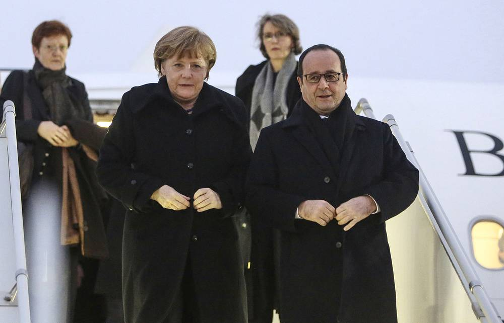 French President Francois Hollande and German Chancellor Angela Merkel arriving in Minsk