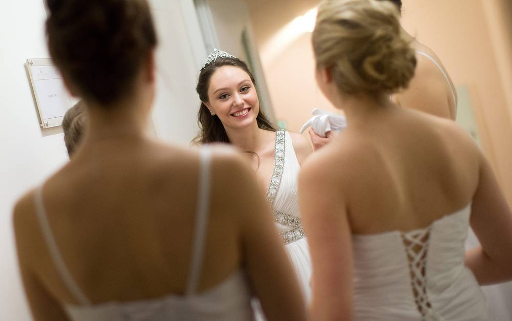 Each year the auditorium of the Vienna State Opera is turned into a large ballroom. Photo: Debutantes preparing for the opening ceremony of the Vienna Opera Ball