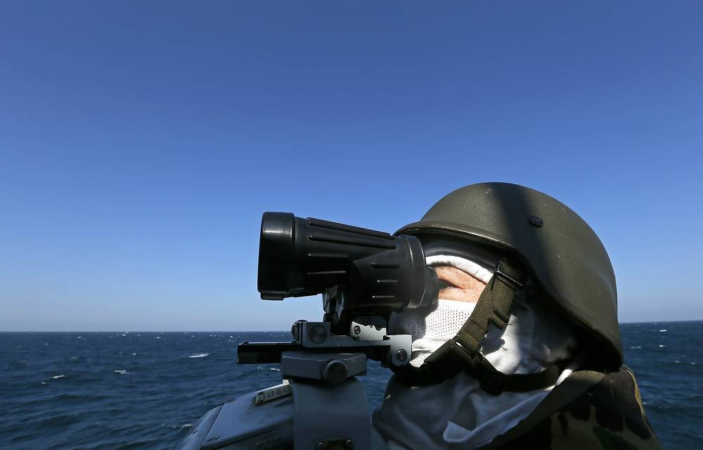A navy officer observes the maneuvers