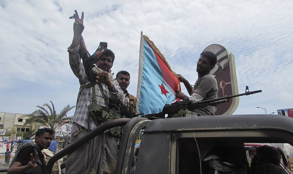 The Council members expressed support for Mansur Hadi as the legitimate president of Yemen. Photo: Militiamen loyal to President Abd Rabbuh Mansur Hadi riding on an army vehicle on a street in Aden, Yemen