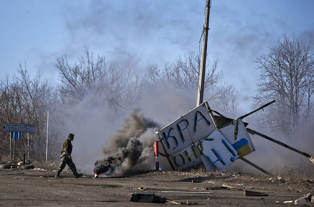 A militia man at a checkpoint in Debaltsevo, Ukraine after the town was left by Ukrainian military, February 2015