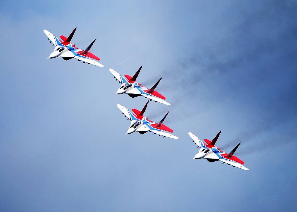 The Strizhi (swifts) aerobatic team training for the parade