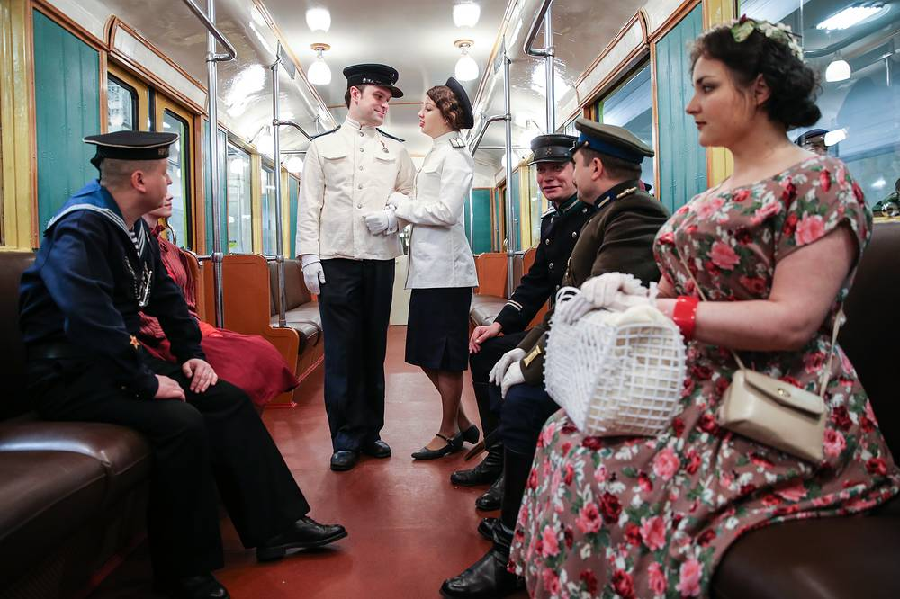 People in retro costumes in a train at Partizanskaya Station as part of celebrations marking the 80th anniversary of the Moscow Metro