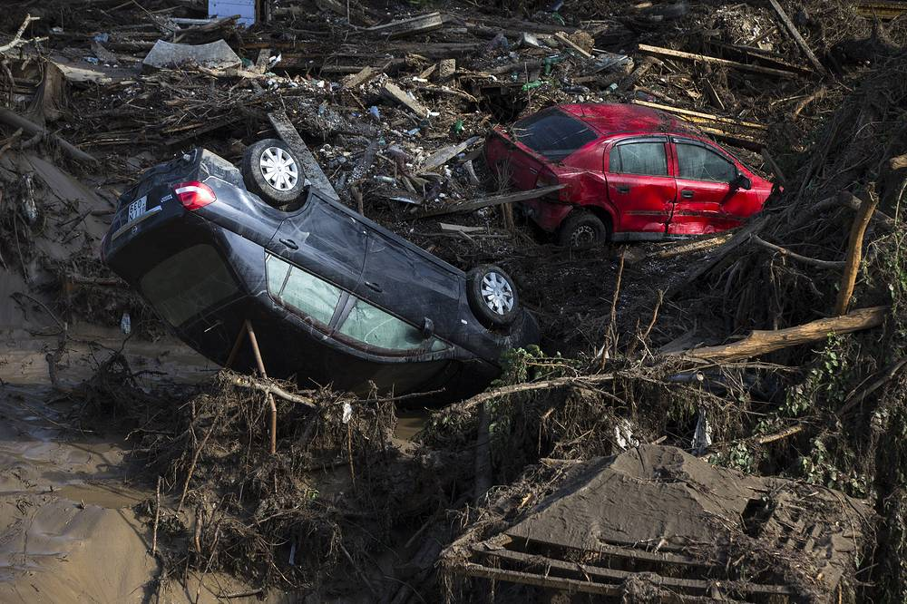 Cars in the mud at a flooded zoo area in Tbilisi