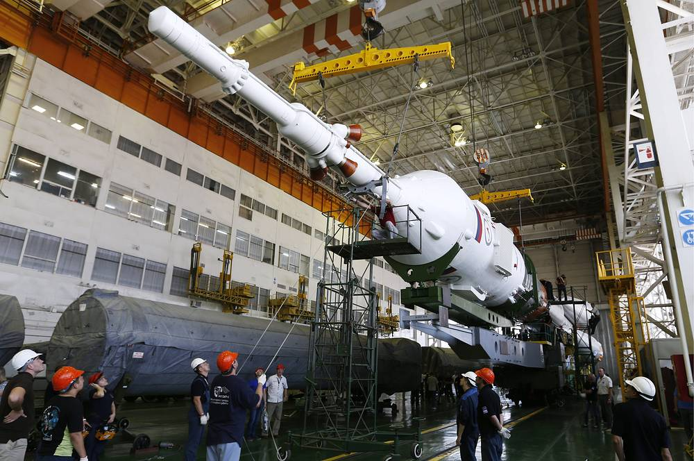 Soyuz TMA 17M spaceship being assembled by Russian space industry workers in the Installation and Test Building at Baikonur cosmodrome