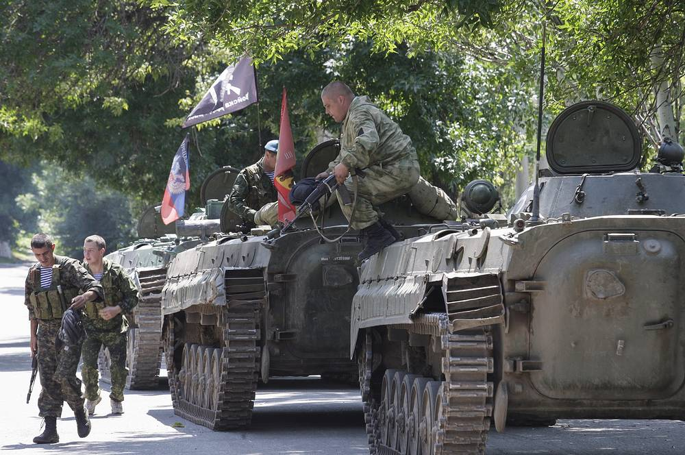 """The [OSCE] Special Monitoring Mission, along with media representatives [...] observed a column of three MBTs (T-64) move approximately 1.28km south-east and into a forest near the town,"" the OSCE report said"
