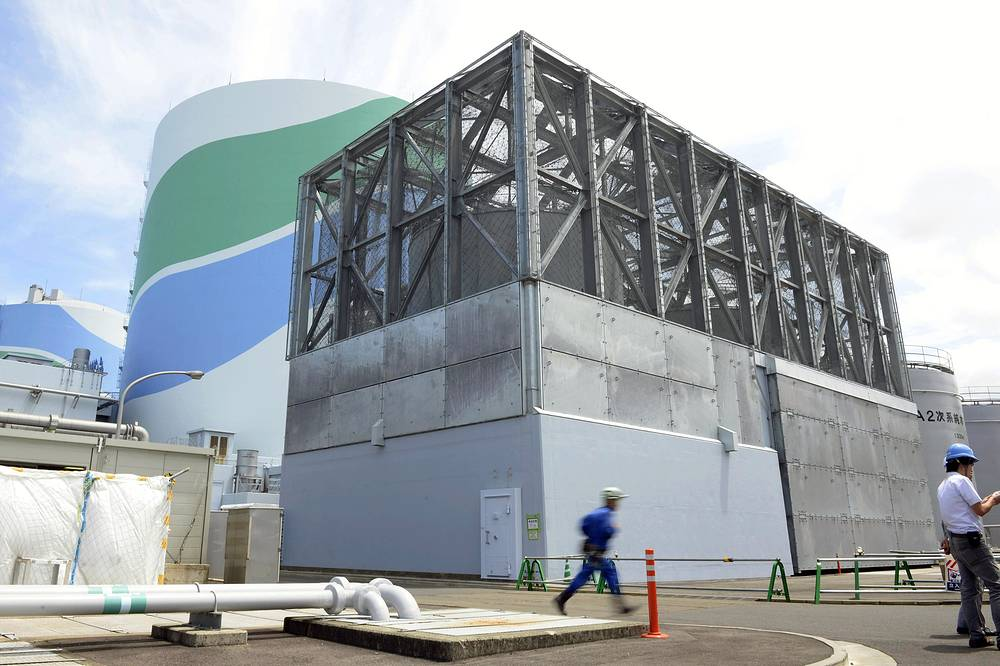 Kyushu Electric Power Co. said Tuesday, it had restarted the No. 1 reactor at its Sendai nuclear plant. Photo: A condensate storage tank which was prepared for tornado at Sendai Nuclear Power Station, Kagoshima prefecture, southern Japan