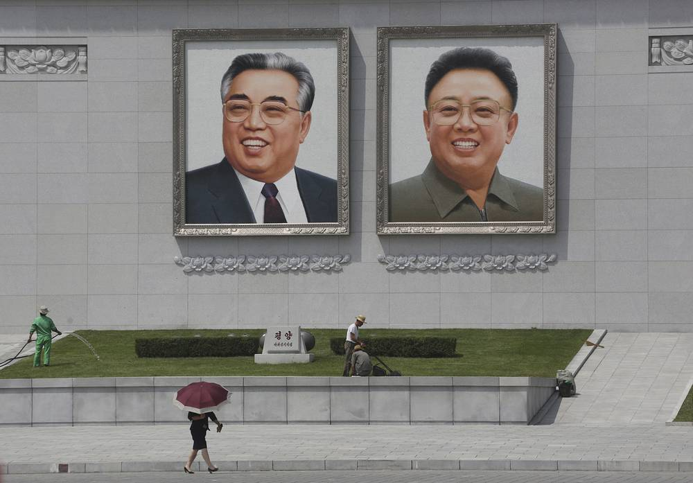 Kim Il-sung Square is the main city square in the center of Pyongyang, and is named after the country's founding leader, Kim Il-sung. Photo: portraits of Kim Il Sung and Kim Jong Il at Kim Il Sung Square