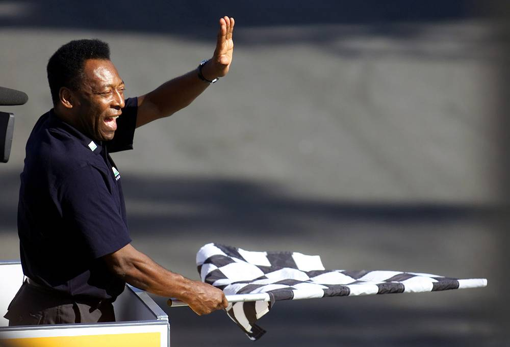 Pele visites not only football matches. The list of his hobbies is very wide. Photo: Brazilian soccer star Pele at Brazilian F1 Grand Prix in Sao Paulo