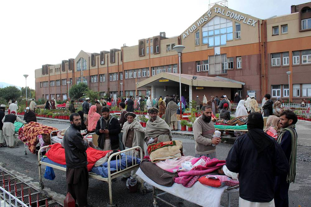 People receiving medical treatment outisde a hospital in Abbottabad, Pakistan