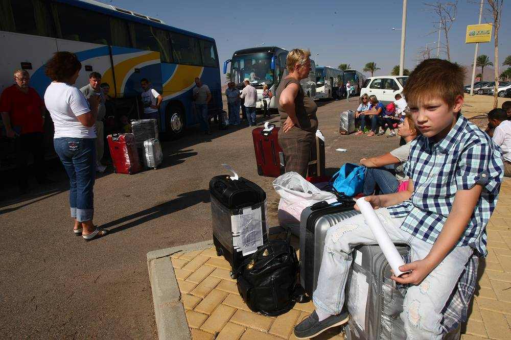 Russian tourists seen by buses at an entrance to the grounds of Sharm el-Sheikh airport
