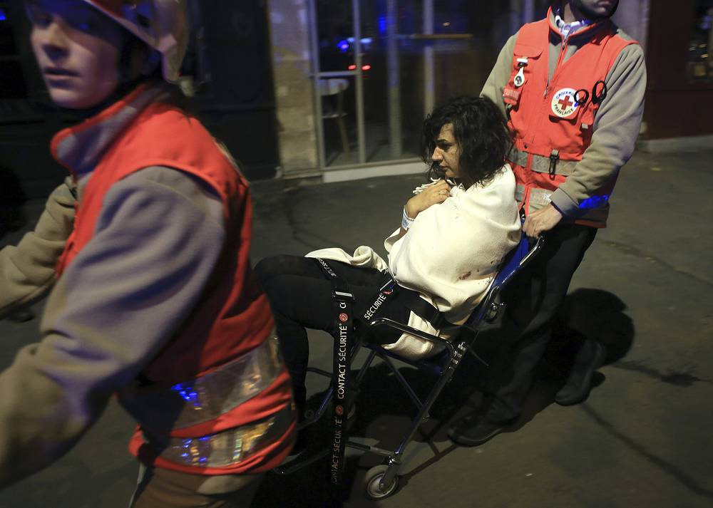 Woman being evacuated from the Bataclan theater