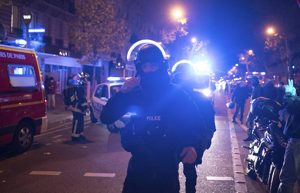 Hostages were taken in the Bataclan concert hall where 1,500 people gathered for a rock concert. Photo: Elite police officers outside the Bataclan theater in Paris