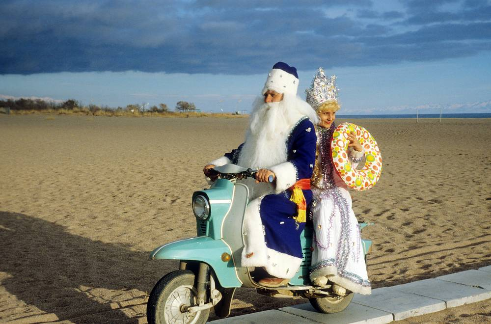 Grandfather Frost and Snow Maiden riding a scooter near the lake Issyk-Kul, Kirghiz SSR, 1981