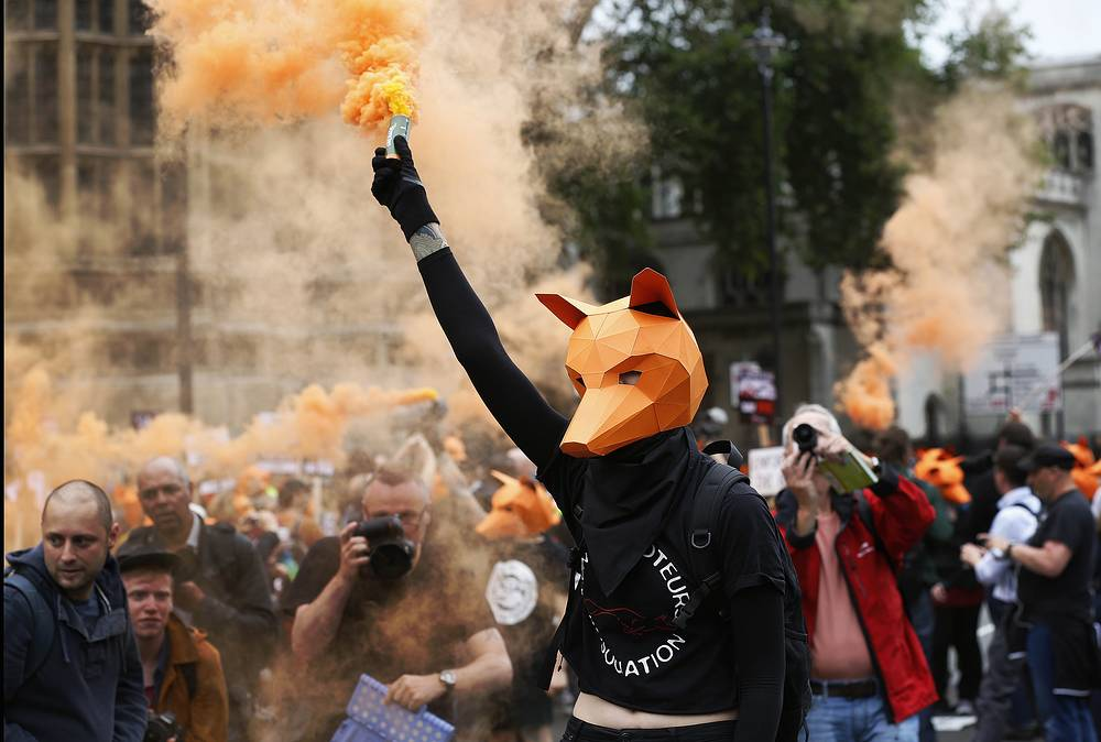 Protestors rally in front of the Houses of Parliament in London against fox hunting