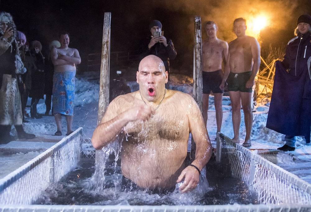 Russian State Duma member, former professional boxer, two-time WBA heavyweight champion Nikolai Valuyev taking a dip in the icy waters through a hole carved into the frozen Yenisei River in Krasnoyarsk