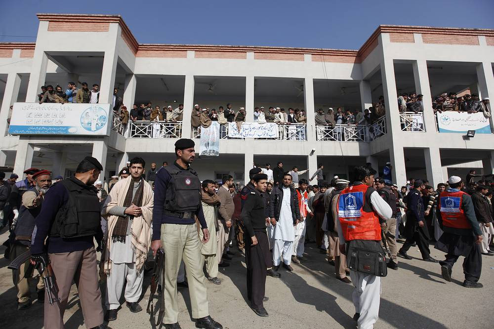 Security officials, rescue workers and relatives outside the hospital after gunmen attacked  Bacha Khan University in Charsadda, Pakistan