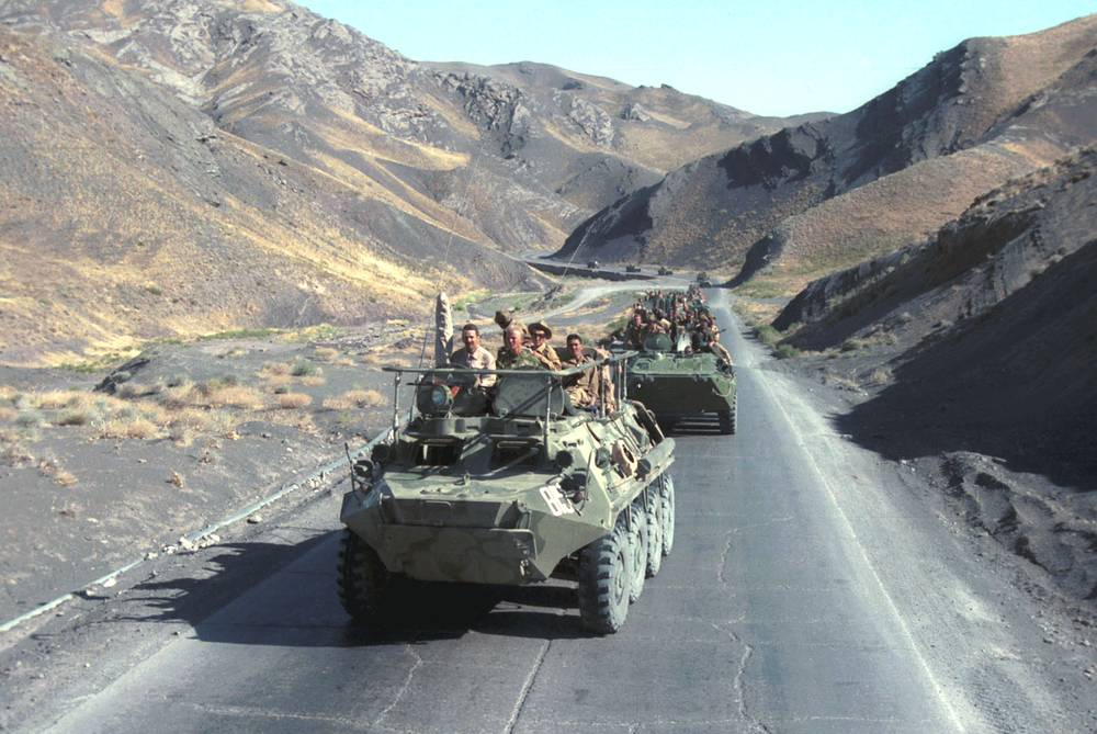 A column of armored personnel carriers riding on the way from Herat to Kushka, Afghanistan, 1988