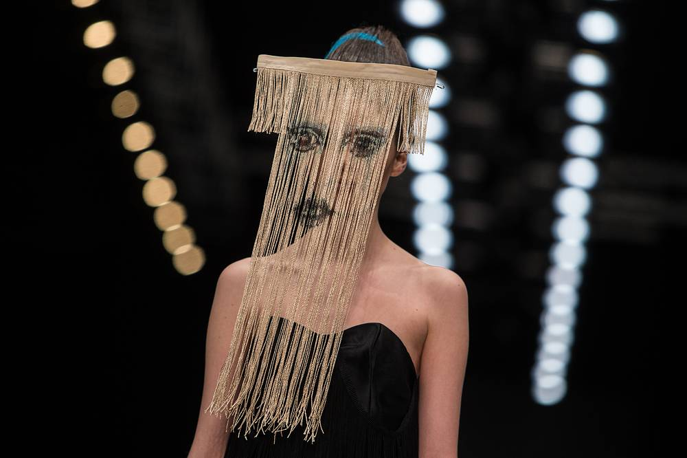 A model displays a creation by Contradiction Fashion group
