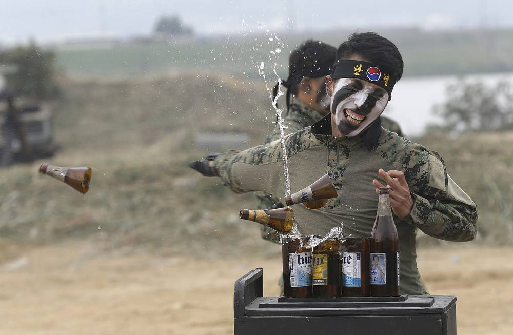 A South Korean army special forces soldier breaks bottles with his hand during the Naktong River Battle re-enactment in Waegwan, South Korea, September 22