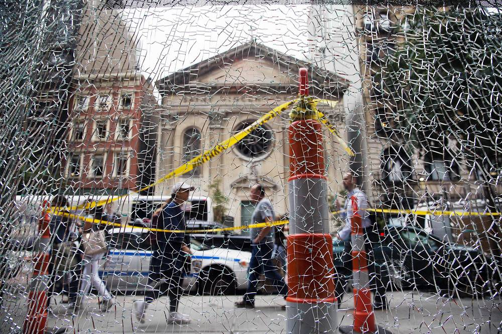 A shattered storefront window after the explosion on Manhattan in New York, September 20