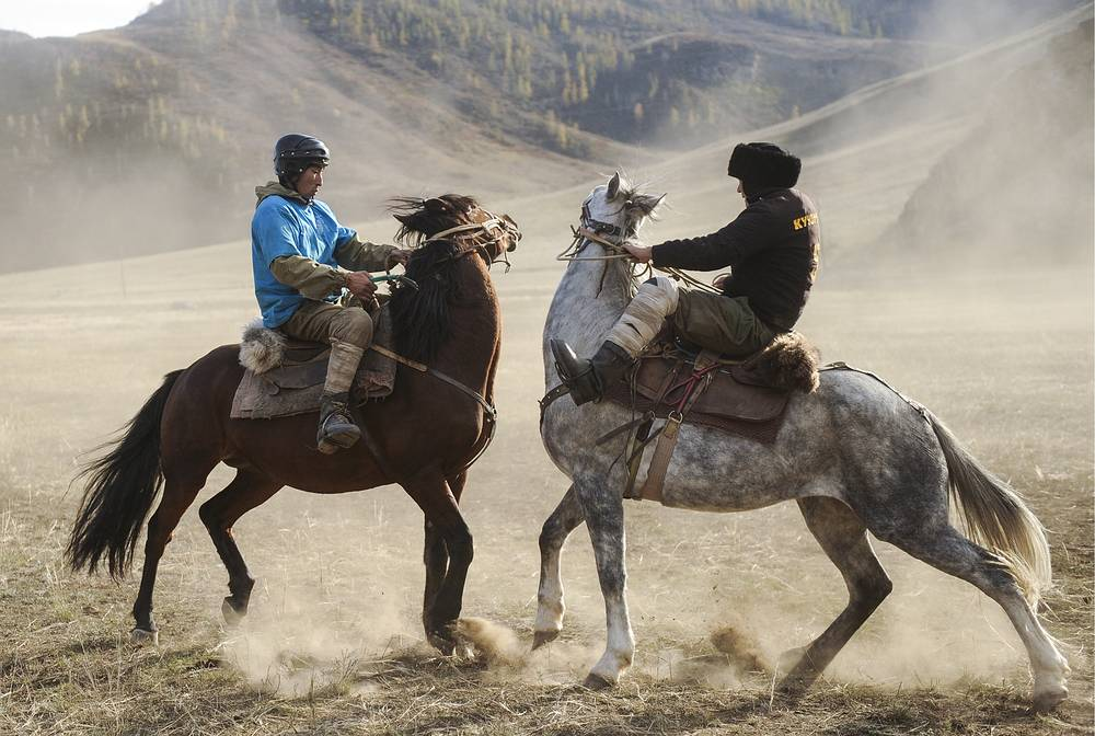 Horses riders play a game of buzkashi, or goat dragging, Russia, October 9
