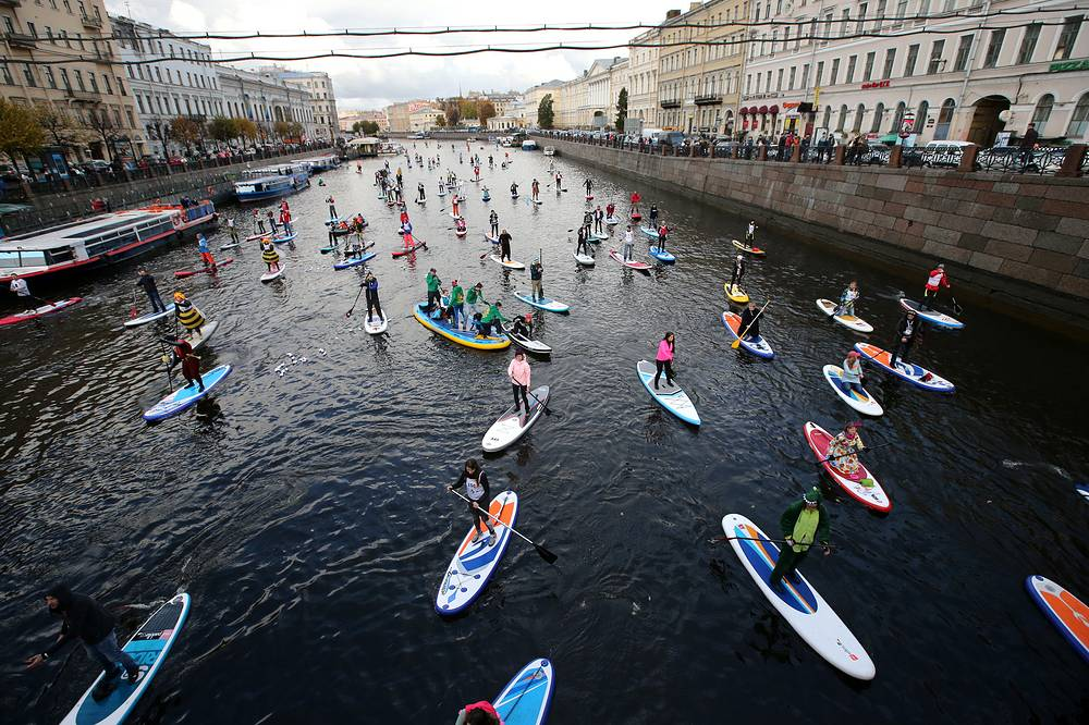 "Participants in the 1st Stand up paddle surfing festival ""Fontanka-SUP"" in Saint Petersburg, October 15"