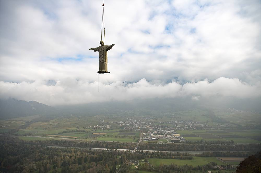An 11-meters-high replica of the 'Christ the Redeemer' statue lifted by a helicopter on the Guschastein hill above Pfaefers, Switzerland, October 27