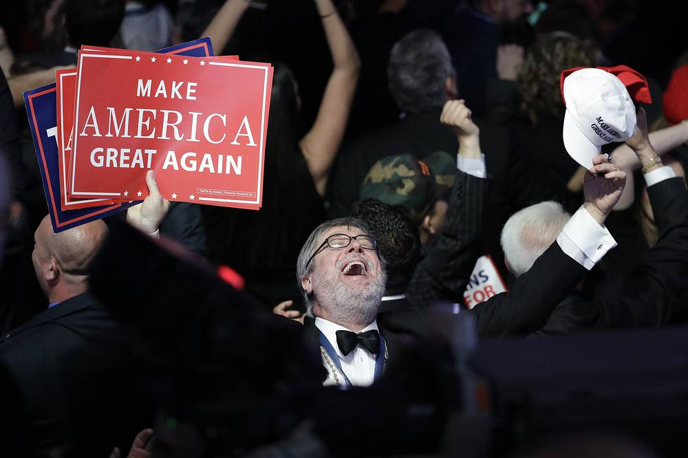 Supporters of Republican presidential candidate Donald Trump react as they watch the election results during Trump's election night rally in New York