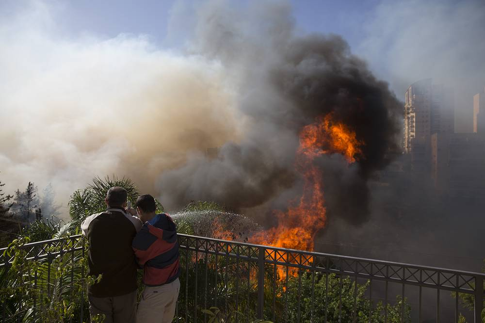 A fire burns in Haifa, Israel
