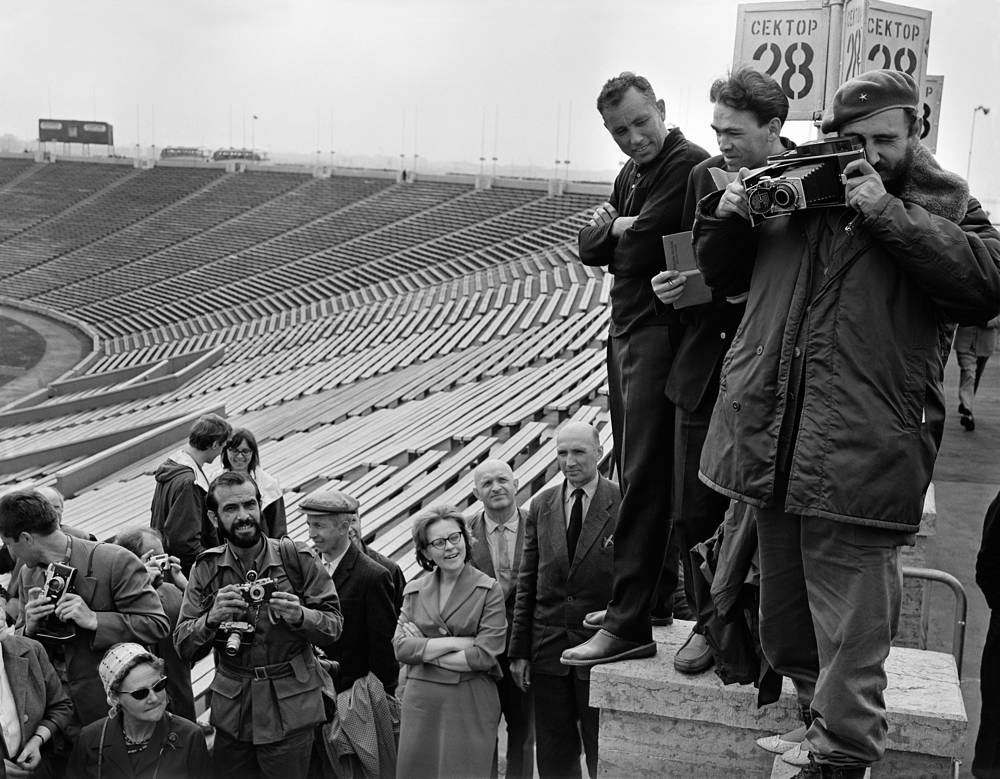 Leader of the Cuban Revolution Fidel Castro taking pictures durin his visit to Leningrad, 1963