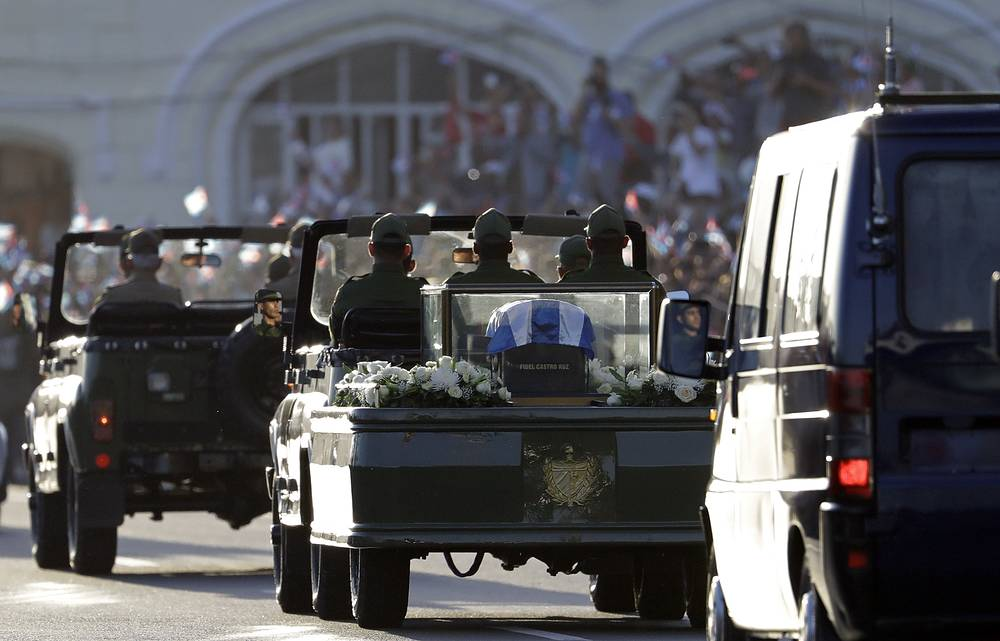 Placed in a small coffin covered by a Cuban flag the ashes of Cuban leader Fidel Castro driven along the streets of the port of Havana, Cuba