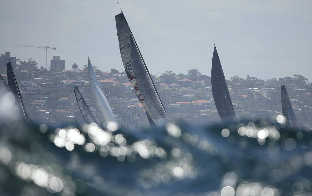 Sails of the yachts seen above the swell during the start of the Sydney Hobart yacht race in Sydney, Australia, December 26
